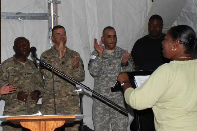 Soldiers and civilians at Camp Marmal who are members of a choir sing during the dedication ceremony of the new Camp Marmal Chapel Sept. 25.