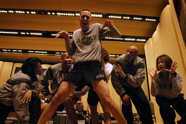 """Staff Sgt. Juan Rodriguez (center) and fellow U.S. Army Band Downrange performers rehearse a song-and dance routine from their upcoming Halloween-themed concert """"Deranged."""""""
