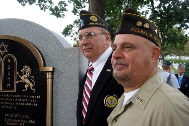 Veterans from New York pose next to the Jewish Chaplains Memorial at Arlington National Cemetery in Arlington, Va., Oct. 24, 2011.
