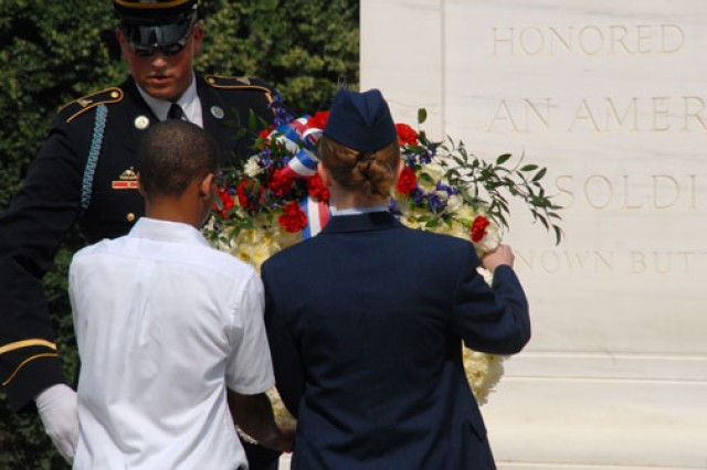 Jeremiah Tate and Civil Air Patrol Cadet Airman 1st Class Kate Davis place the National History Day wreath at the base of the Tomb of the Unknowns in Arlington National Cemetery, Va., June 20.