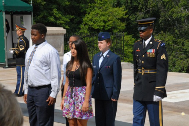 Students participating in the National History Day wreath-laying ceremony: Clockwise from left, Joshua Campbell, Jeremiah Tate, Civil Air Patrol Cadet Airman 1st Class Kate Davis and Amanda Hoskins face the crowd after placing their wreath at the base of the Tomb of the Unknowns at Arlington National Cemetery, Va., June 20. The students are escorted by a member of the 3rd United States Infantry Regiment, The Old Guard.