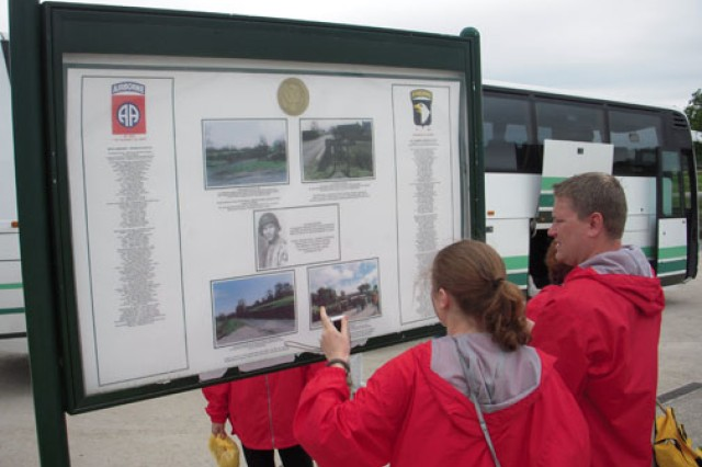 Civil Air Patrol Cadet Airman 1st Class Kate Davis and her teacher, Rob Greenwood, read the Airborne wall at La Fiere, Sainte-Mere-Eglise, France. Not only did they find the name of the Soldier Davis studied as part of her National History Day project, but also that of an uncle of one of Greenwood's friends.
