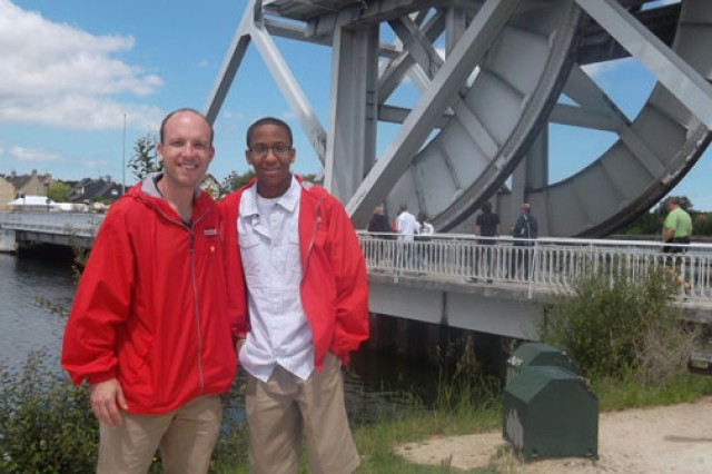 Jeremiah Tate (right) and his instructor, David Wheeler, stand in front of the Pegasus Bridge, which was named after the British units that were commanded to secure the site against German soldiers during the Normandy invasion of World War II.