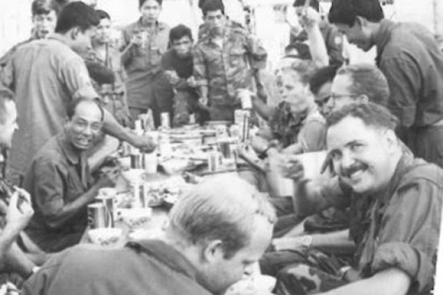 John McCormick (lower right) smiles at the camera during a unit get-together in 1972. McCormick participated in more than 250 combat missions.