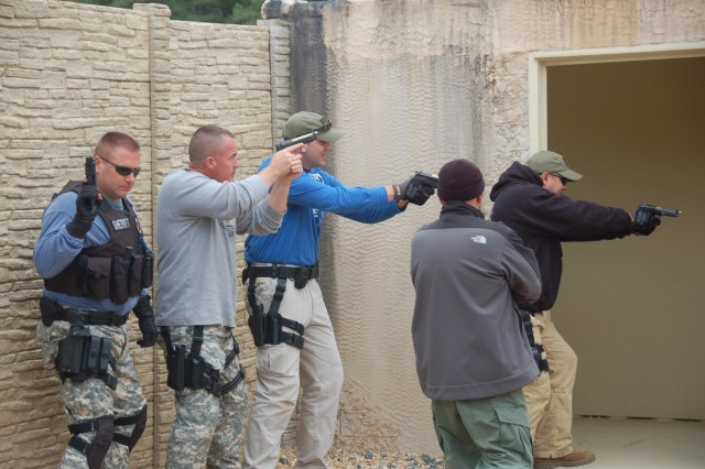 Jared Martin and Dwayne Germer of Quantico Marine Corps Base, Craig Haywood of Caroline County Sheriff's Department and James Simmons of King George County Sheriff's Department participate in an active shooter scenario Oct. 20 at Afghan Village at Fort A.P. Hill.