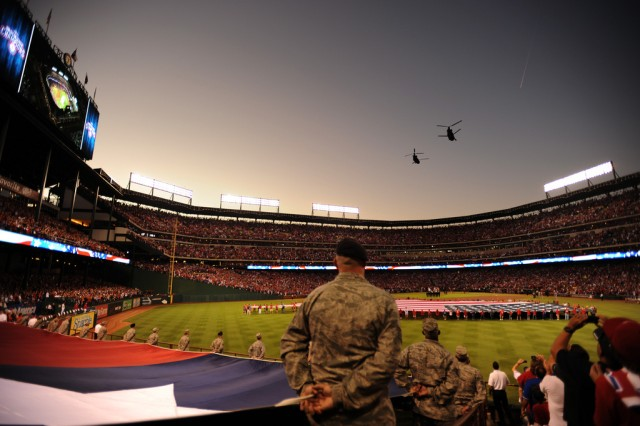 Two CH-47 Chinooks, belonging to the Texas Army National Guard, perform a two ship flyover during Game 4 of the Major League Baseball World Series between the St. Louis Cardinals and the Texas Rangers, Oct. 23, 2011, in Arlington, Texas. Other Game 4 participation from the Texas Military Forces included the singing of the national anthem during the seventh-inning stretch by Chief Warrant Officer 3 Darby Ledbetter.