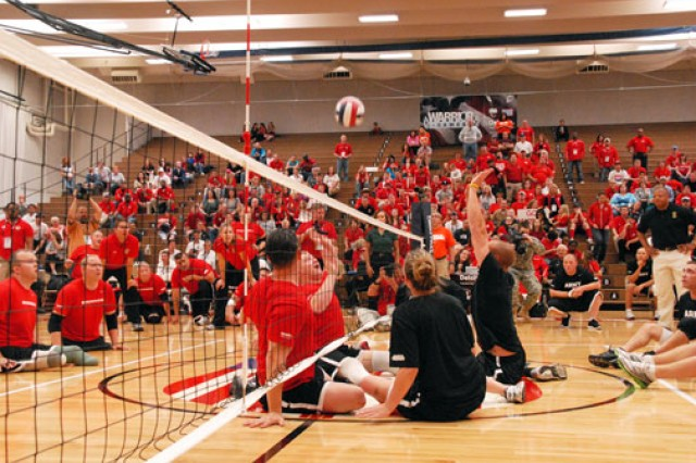 The Marine sitting volleyball team vies for the ball with the Army's team during the final match at the 2011 Warrior Games in Colorado Springs, Colo. The Army took the silver medal for the event.