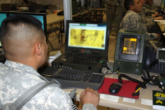 A Soldier from the 2nd Brigade Combat Team, 1st Armored Division enters information into the Advanced Field Artillery Tactical Data System, an automated fire support system that increases the accuracy of fires and reduces the timeline from the sensing of targets to the delivery of fires, during the Army's first Network Integration Evaluation in June at White Sands Missile Range, N.M.