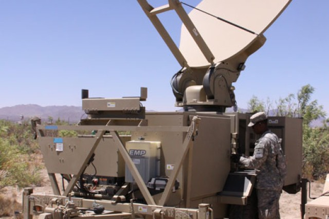 A Soldier from the 2nd Brigade Combat Team, 1st Armored Division inspects Warfighter Information Network-Tactical equipment during the Army's first Network Integration Evaluation in June at White Sands Missile Range, N.M.