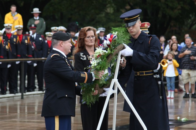 Col. Bill Rabena, deputy G-9 for Warrior and Family Support of the Installation Management Command, and Survivor Ronna Jackson lay a wreath Oct. 13, 2011, at the Tomb of the Unknowns at Arlington National Cemetery, Va., with the assistance of a Soldier from the 3rd U.S. Infantry Regiment, The Old Guard. Accompanying them was Survivor Ricky Adamek. The wreath-laying followed the 2011 Survivor Outreach Services Army Family Action Plan Summit that occurred this week in Arlington, Va.