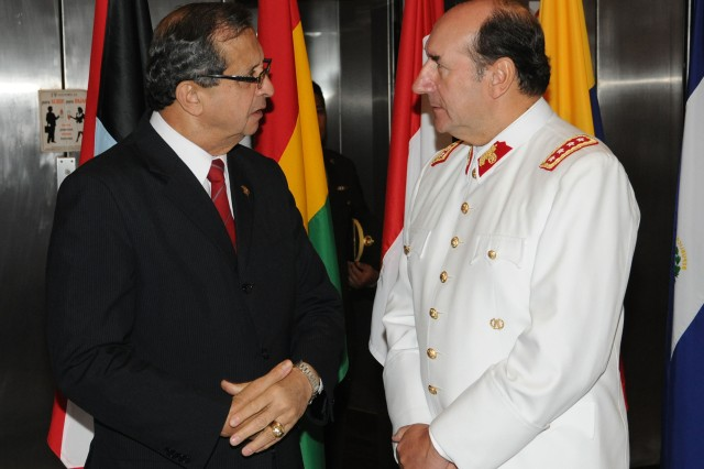 Daniel Mora Zevallos, the Peruvian minister of defense, speaks with Gen. Juan Miguel Fuente-Alba Poblete, the Army commander of the Chilean arm, at the annual Conference of American Armies on Oct 24, 2011.  This annual conference allows senior leaders to discuss lessons learned in bilateral and multinational operations and apply those lessons to individual and shared doctrine, training and force structure.