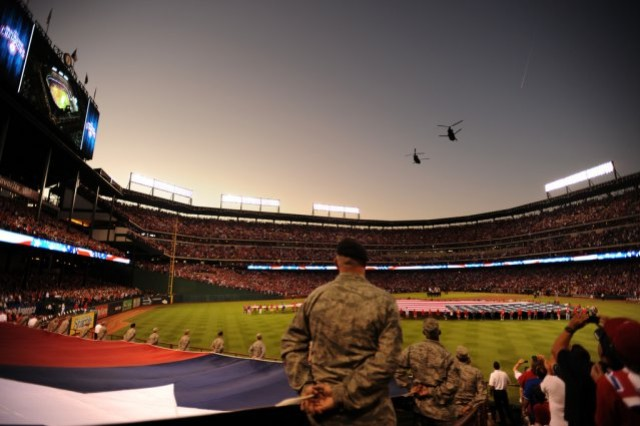 Two CH-47 Chinooks, belonging to the Texas Army National Guard, perform a two ship flyover during Game 4 of the Major League Baseball World Series between the St. Louis Cardinals and the Texas Rangers, Oct. 23, 2011, in Arlington, Texas.