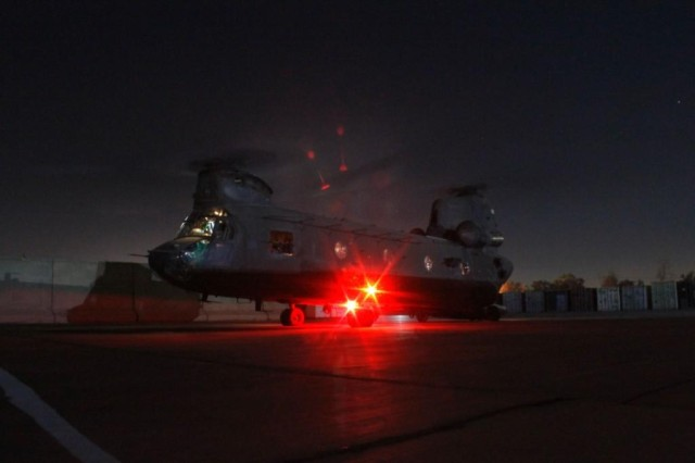 A CH-47 Chinook is about to take off before a mission on the night of Oct. 6, 2011, on Camp Taji, Iraq.