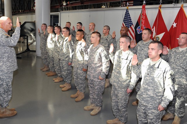 Army Chief of Staff Gen. Raymond T. Odierno raises his right hand and administers the oath to 15 Soldiers with the 1st Brigade Combat Team, 10th Mountain Division (LI), during a reenlistment ceremony Tuesday at Fort Drum, N.Y.