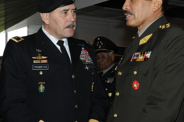 Maj. Gen. Simeon G. Trombitas, U.S. Army South commander, speaks with Gen. Luis Howell Ballena, commander of the Peruvian Joint Command, at the 2011 Conference of American Armies.  This annual conference provides the U.S. Army with continual direct engagement with senior South and Latin American military leadership to ensure a current understanding of partner nations views and the issues facing land force commanders.