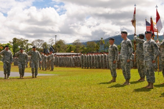 """SCHOFIELD BARRACKS, Hawaii """" Colonel Christopher Vanek and Colonel Malcolm Frost salute the colors while inspecting the troops during the 2nd Brigade Combat Team, 25th Infantry Division Change of Command Ceremony, Sept. 9 at Weyand Field."""