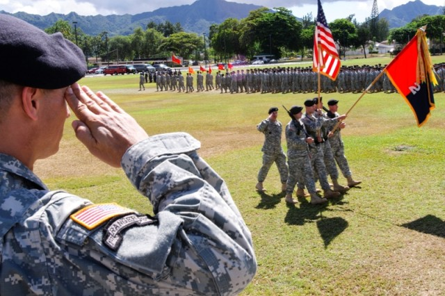 """SCHOFIELD BARRACKS, Hawaii """" Colonel Christopher Vanek salutes the colors during the 2nd Brigade Combat Team, 25th Infantry Division Change of Command Ceremony, Sept. 9 at Weyand Field."""
