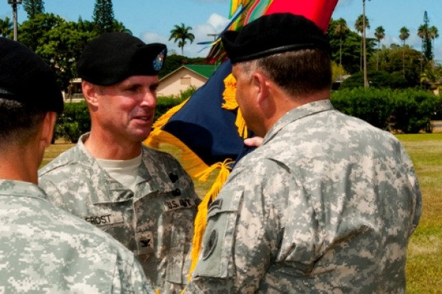 """SCHOFIELD BARRACKS, Hawaii """" Colonel Malcolm Frost passes the brigade colors to Lt. Gen. Francis J. Wiercinski during the 2nd Brigade Combat Team, 25th Infantry Division Change of Command Ceremony, Sept. 9 at Weyand Field."""