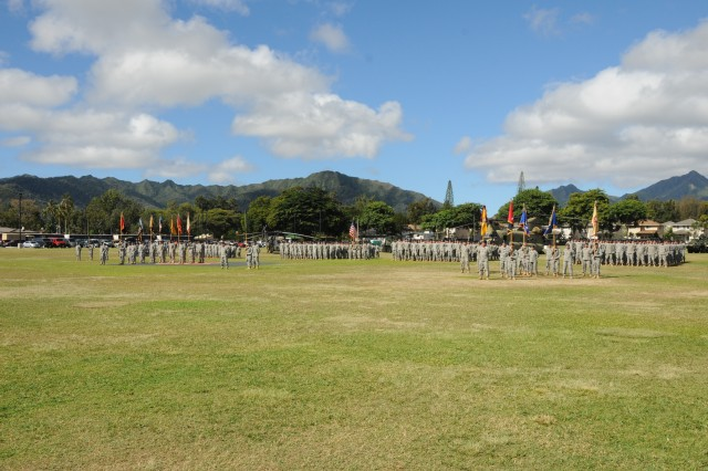 "SCHOFIELD BARRACKS, Hawaii "" Soldiers of the 25th Infantry Division stand at ease during a rededication ceremony of Weyand Field, Sept. 30 at Schofield Barracks, Hawaii."