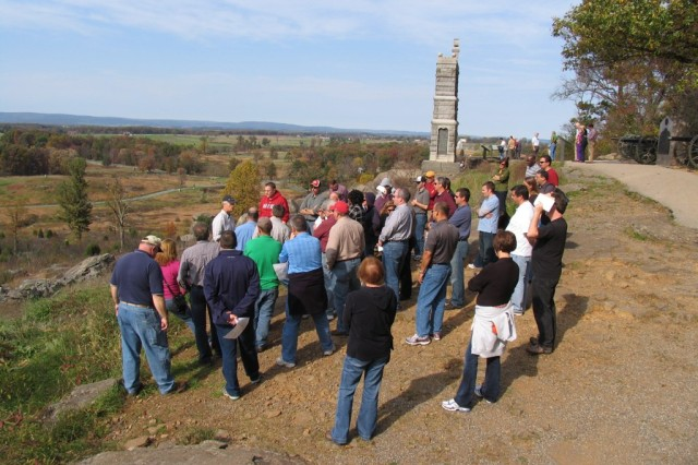 The APG Cohort envisions the flow of battle from atop Little Round Top on the Civil War battlefield at Gettysburg as Dr. Paul Jussel, professor of military studies, Army War College, leads them on a tour.