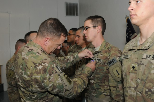 U.S. Army Maj. Gen. William Mayville, commanding general of the 1st Infantry Division based out of Fort Riley, Kan., awards the purple heart to several soldiers of the 3rd Brigade Combat Team, 1st Infantry Division, Task Force Duke, Oct. 24. After the ceremony, Mayville visited with key military leaders from TF Duke as part of a multi-day tour of operations in Regional Command-East.