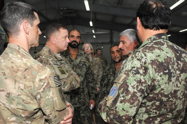U.S. Army Maj. Gen. William Mayville, commanding general of the 1st Infantry Division based out of Fort Riley, Kan., met with Afghan National Army Soldiers on Forward Operating Base Clark, Oct. 25. While on FOB Clark, Mayville awarded three Army Commendation Medals for valor and attended briefings about operations in the area.