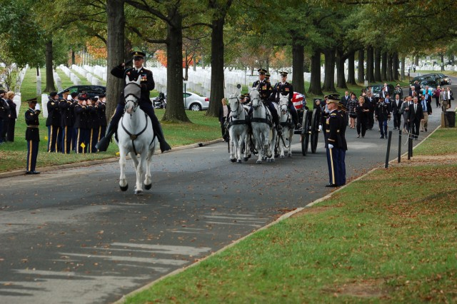 The Old Guard Caisson Platoon carry the group casket representing the remains of 10 Army Airmen from World War II to Section 60 of Arlington National Cemetery, Va., Oct. 26, 2011. Two individual caskets were also interred at the service.
