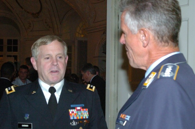 Lt. Gen. John Gardner, the Deputy Commander of the U.S. European Command, and Col. (German) Michael Kuhn, selected as the next commander of German Army forces in Baden-Wurttemberg, discuss various issues of interest to both U.S. and German troops in the region, such as defense budget reductions, and ongoing cooperative training efforts during an invitational reception hosted by Minister President Winfried Kretschmann at Ludwigsburg Palace, Ludwigsburg Germany, October 19.