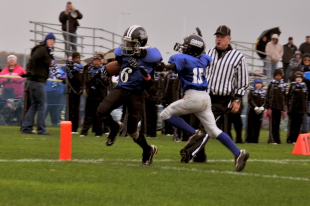 Fort Drum Mountaineers football player Cedarious Barfield, wearing the No. 6 jersey, rushes for a touchdown Oct. 16 against the Watertown Giants during a game at Fort Drum. Except for one loss to Dexter, the Mountaineers closed out their regular season undefeated and now head to the playoffs.
