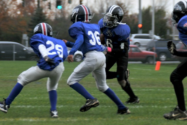 Fort Drum Mountaineers football player Cedarious Barfield, No. 6, runs the ball Oct. 16 while playing against the Watertown Giants during a game at Fort Drum.