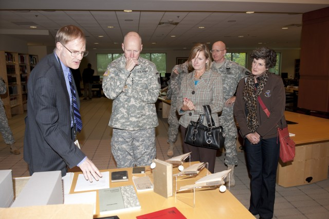 Gen. Bob Cone, Commander, Training and Doctrine Command, talks with Dr. Conrad Crane, director of the Military History Institute, during his visit to the Army War College Oct. 26. Cone was joined by his wife, Jill, and Maj. Gen. Gregg Martin, USAWC Commandant and his wife, Maggie.