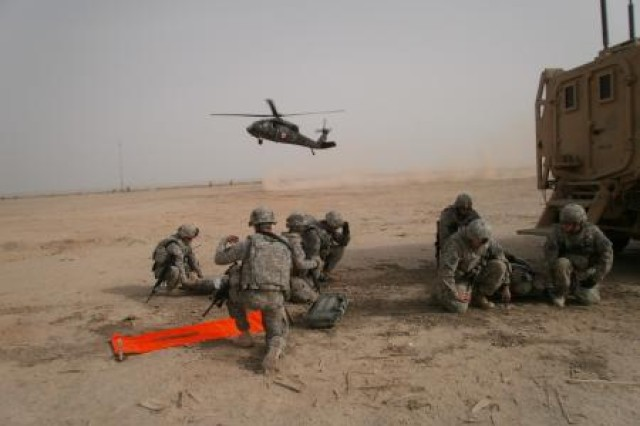 Soldiers with 1-163rd Infantry, 310th Expeditionary Sustainment Command, prepare to move a litter earlier this year for medical evacuation during a training exercise on Contingency Operating Base Adder, Iraq.  Soldiers evacuated from theater are now eligible for $500 Army Emergency Relief grants.