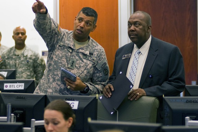 "SHAW AIR FORCE BASE, S.C. (October 26, 2011) "" Third Army/ARCENT Commanding General, Lt. Gen. Vincent K. Brooks (left), highlights some of the command operation intelligence center's capabilities to Randolph Bynum Sr., superintendent of Sumter schools. The COIC's facilities help Lt. Gen. Brooks lead Third Army/ARCENT Soldiers around the world from Patton Hall. (Photos by Staff Sgt. Nicholas Salcido, Third Army/ARCENT public affairs)"