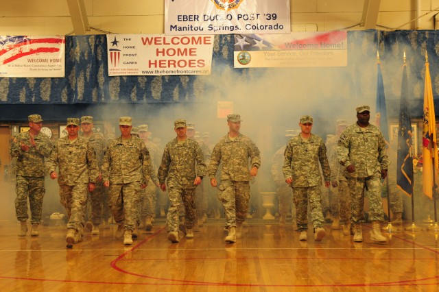FORT CARSON, Colo. -- Soldiers assigned to Division Special Troops Battalion, 4th Infantry Division, enter the Special Events Center during a welcome home ceremony Oct. 17 prior to reuniting with their Families and loved ones after a yearlong deployment to northern Iraq in support of Operation New Dawn.
