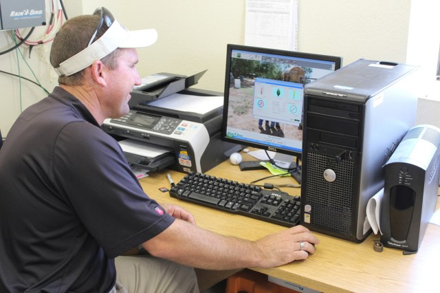 Monte Reed, superintendent of Courses at Clear Creek at Fort Hood, Texas, logs in to review data collected by the weather station to determine watering needs for the golf complex.