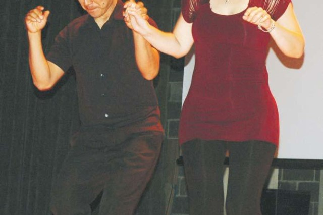 (Right) Jesus Obregon, who owns the Baltimore dance studio Maryland Salsa, danced the merengue and bachata at the Oct. 13 event.