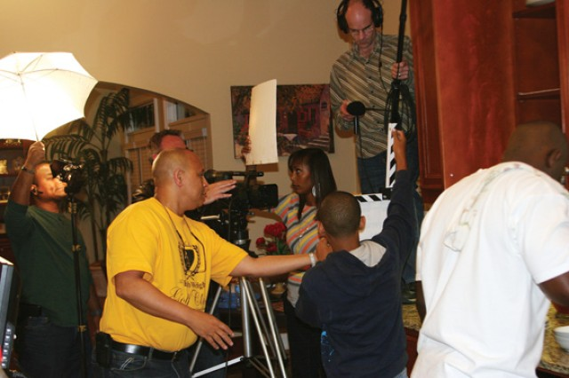 Ty Manns, writer and director of The Turning Point, helps set up a scene at his Phenix City home Friday. His wife, Mia (pictured), plays Cheryl in the movie.