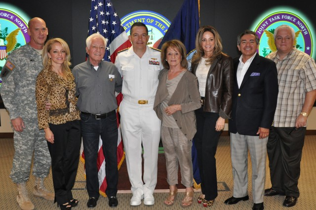"""FORT BLISS, Texas -- The family of Navy Vietnam veteran Gustavo """"Gus"""" Rodriguez Sr. joined him and the ceremony host, Navy Rear Adm. David A. Dunaway, commander of the Navy's Operational Test and Evaluation Force, after the surprise award ceremony. From left: Rodriguez's son-in-law, Col. Forrest E. Smith, JTF North Chief of Staff, and his wife, Elma; Rodriguez; Dunaway; Rodriguez's wife, Elma; daughter, Monica, and her husband, Gabe Gonzalez; and Rodriguez's son, Gustavo """"Gus"""" Rodriguez Jr., who planned the event."""