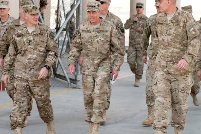 Gen. David Petraeus walks with the current commander of ISAF Joint Command in Kabul. Petraeus took the opportunity before his retirement to visit Lt. Gen. David Rodriguez, right, and Lt. Gen. Mike Scaparrotti.