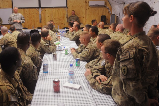 Sgt. Annie Fulkerson, with the 1st Stryker Brigade Combat Team, 25th Infantry Division, asks Sergeant Major of the Army Raymond F. Chandler III a question Oct. 20 at Forward Operating Base Masum Ghar, Afghanistan.