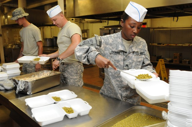 Staff Sgt. Princessunique Thomas, right, and Sgt. Justin Gonzalez, food service specialists assigned to the 2nd Brigade, 82nd Airborne Division, fill to-go plates for hungry Paratroopers at the dining facility on Camp Ramadi, Iraq, Oct. 26. The cooks prepare the plates for Soldiers who cannot come to the DFAC during meal hours because they are on mission or pulling guard duty. The 2/82 cooks took control of the DFAC from KBR civilian contractors on Oct. 25, and will continue keeping soldiers' stomachs full of hot chow for as long as possible. Thomas is assigned to E Co., 407th Brigade Support Battalion, and is a native of Bronx, N.Y. Gonzalez is assigned to Headquarters Co., 2nd Brigade Special Troops Battalion, and hails from Houston, Texas.