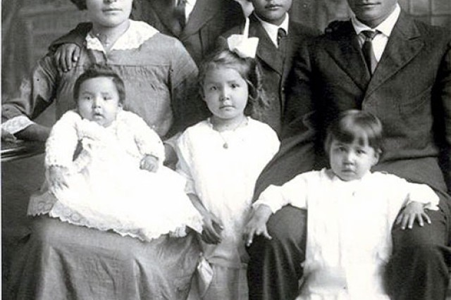 """Harry DeSmet Thompson stands next to his father, Harry William Thompson,a Teton Sioux Indian, around the year 1916. He was the oldest of 12 children born to H.W. Thompson and Mary """"Mamie"""" DeSmet Thompson, the great granddaughter of Lewis and Clark Expedition explorer Meriwether Lewis."""