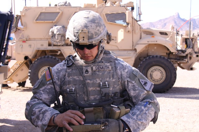 A 2nd Brigade, 1st Armored Division Soldier demonstrates a Joint Battle Command-Platform Handheld, which is used with the Joint Tactical Radio System Rifleman Radio, on Oct. 25, 2011. The handhelds and radios are being evaluated as part of the Army's Network Integration Evaluation 12.1, which officially begins at White Sands Missile Range, N.M., and Fort Bliss, Texas, on Oct. 31, 2011. The handhelds and radios enable lower-echelon Soldiers to better communicate with one another and higher headquarters.