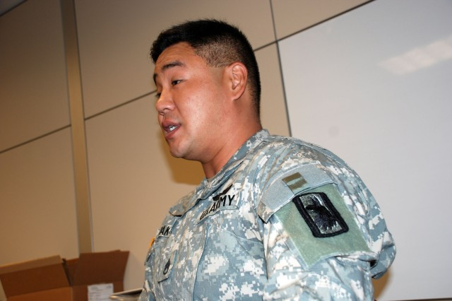 Staff Sgt. Hwon Pak, Intelligence and Security Command Language Professional of the Year, discusses some of his language-learning experiences. (U.S. Army photo by Gregory Ripps)