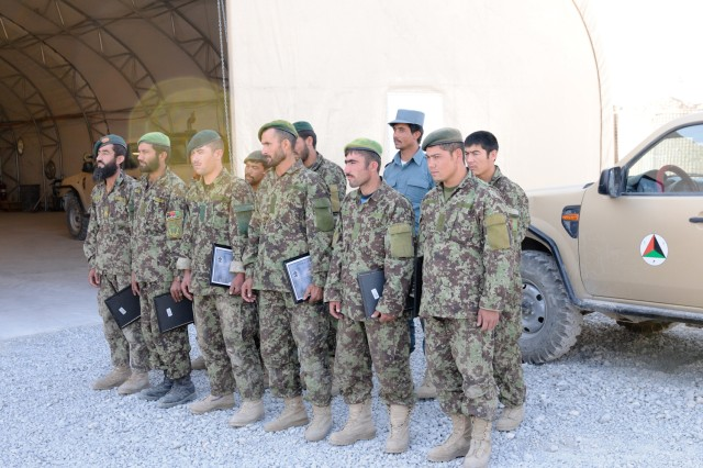 Afghan National Army Soldiers and Afghan National Police graduate from a three-day mechanic course held at Forward Operating Base Pasab, Afghanistan, Oct. 19, 2011.