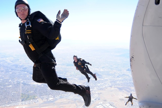 U.S. Army Golden Knights Parachute Team members Sgt. 1st Class Joe Jones, (left) Sgt. Richard Sloan (center) and Sgt. Daniel Cook descend after jumping out of the Knights' C-31 during their Oct. 23, 2011, performance above Biggs Army Airfield at Fort Bliss, Texas, as part of the 30th Annual Amigo Airsho.