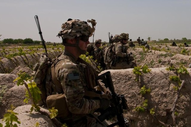 Troopers from 4th Squadron, 4th Cavalry Regiment, 1st Heavy Brigade Combat Team, 1st Infantry Division, patrol the central Zhari district of Afghanistan's Kandahar Province. Almost ninety percent of the squadron has been under enemy fire at least once and almost 20 percent have received Purple Heart medals for wounds received in combat.