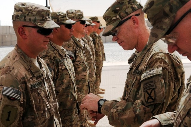 Soldiers assigned to D Company, 2nd Battalion, 34th Armor Regiment, 1st Heavy Brigade Combat Team, 1st Infantry Division, are recognized by Col. Patrick D. Frank, Task Force Spartan commander during a ceremony Sept. 4, 2011, in Afghanistan. The commander of 2nd Bn., 34th Armor Regt., Lt. Col. Christopher Kidd, spoke to reporters Oct. 28, 2011, from Afghanistan via video teleconference.