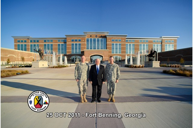 Under Secretary of the Army, HON Dr. Joseph W. Westphal (center) is pictured with BG Thomas S. James (right), Commandant United States Army Armor School (USAARMS) and COL(P) Walter Piatt (left), Commandant United States Army Infantry School. The Under Secretary of the Army visited Fort Benning to gain situational awareness and ensure the Army is correctly prioritizing, balancing and integrating resources to support the mission of this vital installation. HON Dr. Westphal received updates from the Infantry and Armor School Commandants and visited various tenant units/organizations. Fort Benning's newly renovated headquarters building, McGinnis-Wickham Hall, is pictured in the background.