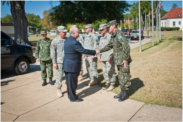 Under Secretary of the Army, HON Dr. Joseph W. Westphal is greeted by international students enrolled in the Western Hemisphere Institute for Security Cooperation (WHINSEC). The institute provides professional education and training to eligible military, law enforcement and civilian personnel from nations throughout the Western Hemisphere. The curriculum is based on the democratic principles set forth in the Charter of Organization of American States and promotes respect for human rights, security cooperation, and the value of partnerships and democratic values in the Western Hemisphere. The Under Secretary of the Army visited Fort Benning to gain situational awareness and ensure the Army is correctly prioritizing, balancing and integrating resources to support the mission of this vital institute.